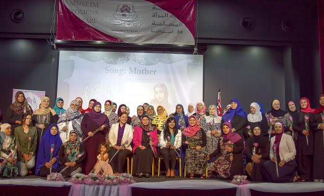 Senior women receiving token of appreciation